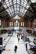 A man walks across the concourse of Liverpool Street Station in what would normally be the rush hour in the City of London on March 17th, 2020. The financial district of the UK is unusually quiet after the government requested people to refrain from all but essential travel and activities yesterday.