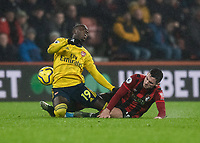 Bournemouth's Lewis Cook (right) tackle brings down Arsenal's Nicolas Pepe (right)<br /><br />Photographer David Horton/CameraSport<br /><br />The Premier League - Bournemouth v Arsenal - Thursday 26th December 2019 - Vitality Stadium - Bournemouth<br /><br />World Copyright © 2019 CameraSport. All rights reserved. 43 Linden Ave. Countesthorpe. Leicester. England. LE8 5PG - Tel: +44 (0) 116 277 4147 - admin@camerasport.com - www.camerasport.com