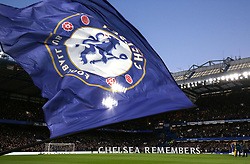 5 November 2017 - Premier League Football - Chelsea v Manchester United - Large letters spell out Chelsea Remembers as a large Chelsea flag is waved in the foreground during the Remembrance Day ceremony at Stamford Bridge - Photo: Charlotte Wilson / Offside