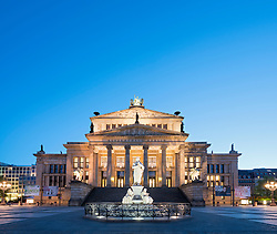 Schiller Statue and Konzerthaus in Gendarmenmarkt square in the evening in Mitte Berlin Germany