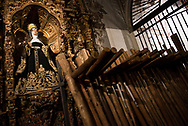 Wooden crosses waiting to be carried by the penitentes belonging to a procession leaving from Santa Maria Magdalena church. Seville, Spain