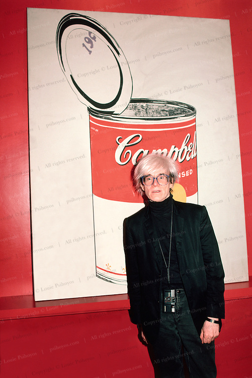 Andy Warhol, influencial American Pop Artist with Campbell's Soup painting at his apartment in New York shortly before his death.