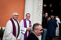 ROME, ITALY - MARCH 10: Parishioners smile at well-wishers outside the gate of the Our Lady of Guadalupe church in the Monte Mario district, where U.S. Cardinal Timothy Dolan of New York City is giving a Sunday Mass, in Rome, Italy, on March 10, 2013. Cardinals are set to enter the conclave to elect a successor to Pope Benedict XVI after he became the first pope in 600 years to resign from the role. The conclave is scheduled to start on March 12 inside the Sistine Chapel and will be attended by 115 cardinals as they vote to select the 266th Pope of the Catholic Church...Gianni Cipriano for The New York Times