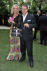 BEN & CHANTAL HUGHES at a garden party hosted by Piaget at The Hempel Hotel, London on 14th July 2011.