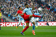 Nathaniel Clyne of Liverpool (l) get his foot to the ball in front of Raheem Sterling of Manchester City. Capital One Cup Final, Liverpool v Manchester City at Wembley stadium in London, England on Sunday 28th Feb 2016. pic by Chris Stading, Andrew Orchard sports photography.