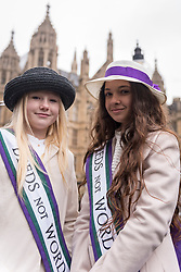 © Licensed to London News Pictures. 04/03/2018. LONDON, UK. Girls dressed as suffragettes join the march. Hundreds of men and women take part in the annual March 4 Women campaigning for gender equality.  The walk through central London from Millbank to Trafalgar Square retraces the steps of Suffragette's ahead of International Women's Day on 8 March.  Photo credit: Stephen Chung/LNP