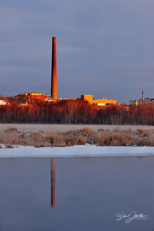 Vale Superstack reflected in Junction Creek, Greater Sudbury, Ontario, Canada