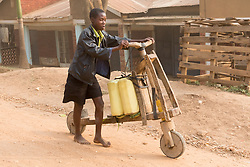 Boy and Wooden Bicycle Carrying Containers