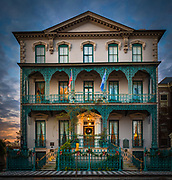 The Governor John Rutledge House is a historic house in Charleston, South Carolina. Completed in 1763 by an unknown architect, it was the home of John Rutledge, a Governor of South Carolina and a signer of the United States Constitution. It was declared a National Historic Landmark in 1973.<br /> <br /> The John Rutledge House is located in historic Charleston, on the north side of Broad Street, opposite its junction with Orange Street, and the Edward Rutledge House, the home of John's brother. It is a tall three-story structure, rendered even taller by its placement on a raised basement. It has a hip roof with a front-facing gable, stuccoed walls, and corner quoining. The front facade is distinguished by an ornate two-story wrought iron balcony, which is believed to have been made by Christopher Werner.<br /> <br /> The house was built as a two-story structure for John Rutledge in 1763, by which time he had already established a successful law practice. Rutledge played a significant role in organizing the Patriot forces of South Carolina during the American Revolutionary War, serving as the state's executive for much of the conflict. He also attended the Constitutional Convention of 1787, and is a signer of the United States Constitution. The house passed out of his family, and was enlarged by the addition of the third story in 1853 by Thomas M. Gadsden. The house served as a law office in the 20th century.
