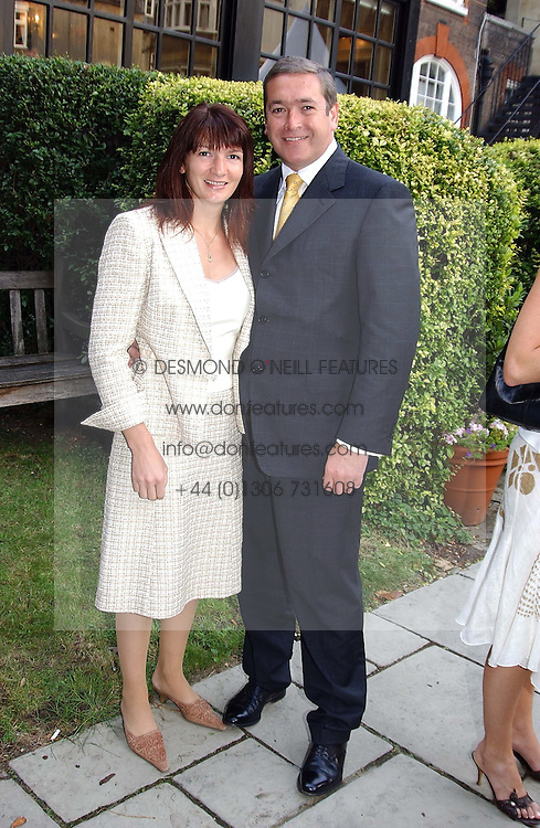British Olympic Dressage rider NICOLA McGIVEN and her husband JOHN McGIVEN at a garden party at the Goring Hotel, Beeston Palce, London SW1 to celebrate the unveiling of a bronze bust the late Queen Elizabeth the Queen Mother on 20th July 2004.