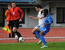 Mbida Bindzi Ebila Jean #14 of ND Gorica vs. Rok Buzeti #14 of ND Mura 5 during football match between ND Gorica and ND Mura 05 in 20th Round of PrvaLiga NZS 2012/13 on November 24, 2012 in Nova Gorica, Slovenia. (Photo By Ales Cipot / Sportida)