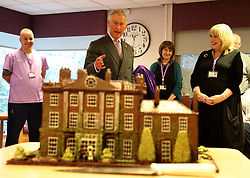 Prince Charles (known as The Duke of Rothesay when in Scotland) with a cake of Highgrove House he donated during his visit to the Ayrshire Hospice in Ayr where he met patients and their families, staff and volunteers.