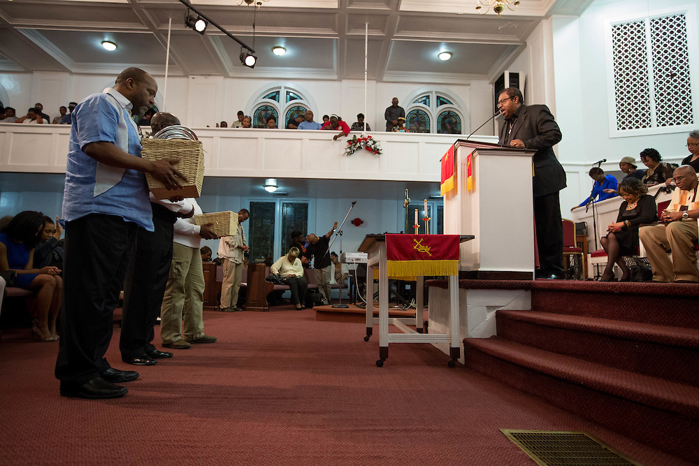 Senior Pastor Timothy McDonald, III, of First Iconium Baptist Church prays over an offering taken up during a rally there in Atlanta on Tuesday, April 7, 2015, to ask for leniency in the sentencing of 11 APS educators found guilty of cheating. The offering was taken to help with those in jail and their families. Sentencing will take place Monday. Photo by Kevin Liles for The New York Times