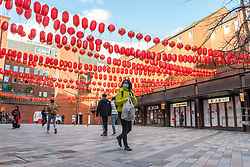 © Licensed to London News Pictures. 05/02/2021. LONDON, UK. Traditional red lanterns have been hung overhead in Chinatown ahead of the Chinese New Year festival, the Year of the Ox.   The normal parade and festivities have been cancelled this year due to the ongoing coronavirus pandemic and the organisers will instead host celebrations online.  Photo credit: Stephen Chung/LNP