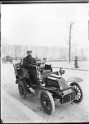 man posing in automobile in Jardin des Tuileness Paris around 1900