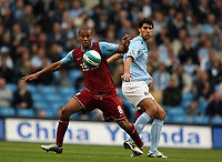 Photo: Paul Greenwood.<br />Manchester City v Aston Villa. The FA Barclays Premiership. 16/09/2007.<br />Villa's Luke Moore (L) beats Vedran Corluka to the ball