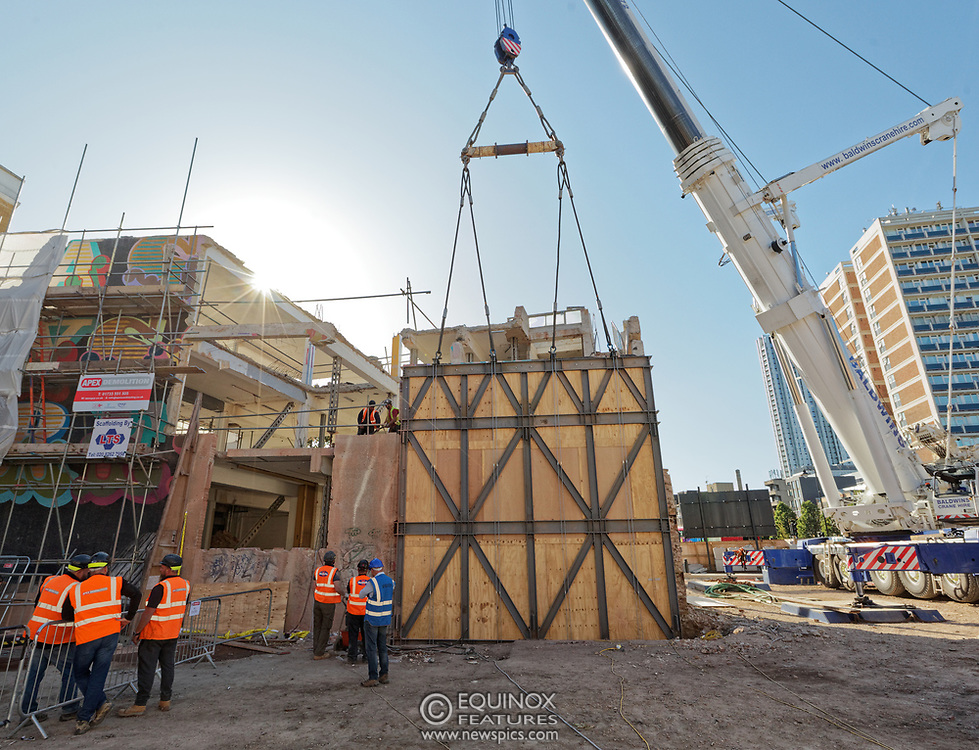 London, United Kingdom - 20 September 2019<br /> EXCLUSIVE SET - Aerial construction specialists and demolition experts use a huge crane to carefully lift intact, a twenty five ton, two-story wall, to preserve a famous Banksy rat image which has been covered up for years. Teams from specialist companies have spent over six weeks cutting around the artwork and fitting custom made eight ton steel supports to enable them to save the historic piece of art. Work has started on the construction of a new twenty seven floor art'otel hotel on the site of the old Foundry building in Shoreditch, east London, and a condition of the planning permission was to preserve the historical Banksy graffiti. A second section of the painting, an image of a TV being thrown through a broken window has already been cut out and moved separately. After the hotel construction is complete the two parts of the Banksy painting will be displayed on the hotel. Our pictures show the stages of work to protect the image, culminating in the lifting of the three story wall by crane. Video footage also available.<br /> (photo by: EQUINOXFEATURES.COM)<br /> Picture Data:<br /> Photographer: Equinox Features<br /> Copyright: ©2019 Equinox Licensing Ltd. +443700 780000<br /> Contact: Equinox Features<br /> Date Taken: 20190920<br /> Time Taken: 15512542<br /> www.newspics.com