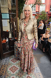 VIRGINIA BATES at a party to celebrate the launch of Laura Mercier's perfume Ambre Pssion Elixir held at Momo's, 25-27 Heddon Street, London on 27th May 2010.
