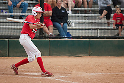 15 April 2012:  Lauren Kellar smacks the ball into the dirt but beats the ball and is safe at first during an NCAA women's softball game between the Drake Bulldogs and the Illinois State Redbirds on Marian Kneer Field in Normal IL