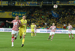 October 9, 2017 - Kiev, Ukraine - Ukraine's  Denys Garmash (R) in action against Croatia's Dejan Lovren (L) during the FIFA 2018 World Cup Group I Qualifier between Ukraine and Croatia at Kiev Olympic Stadium on October 9, 2017 in Kiev, Ukraine. Ukraine fail to reach the play-offs as they lose 2-0. (Credit Image: © Sergii Kharchenko/NurPhoto via ZUMA Press)
