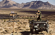 Tom Beck aims a machine gun from his jeep. Attending the Soldier of Fortune Convention, Las Vegas. MODEL RELEASED.