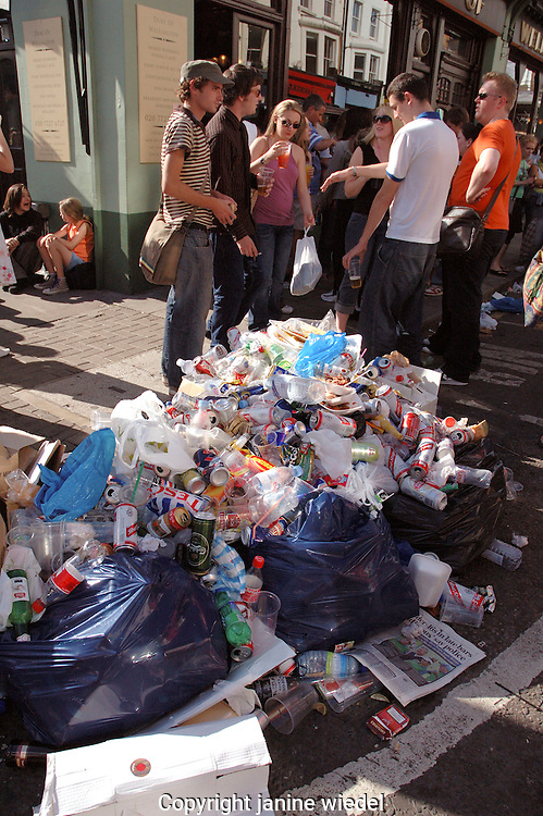 Huge heap of garbage and fast food waste during Carnival in Notting Hill west London.