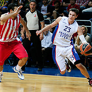 Anadolu Efes's Matthew Janning (R) during their Gloria Cup Basketball Tournament match Anadolu Efes between Olympiacos at Ulker Sports Arena in istanbul Turkey on Tuesday 23 September 2014. Photo by Aykut AKICI/TURKPIX