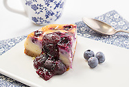 Baked blueberry cheesecake pictured at P&O Cruises Development Kitchen for the Macmillan Cancer Support cookery book.<br /> Picture date: Friday April 29, 2016.<br /> Photograph by Christopher Ison ©<br /> 07544044177<br /> chris@christopherison.com<br /> www.christopherison.com