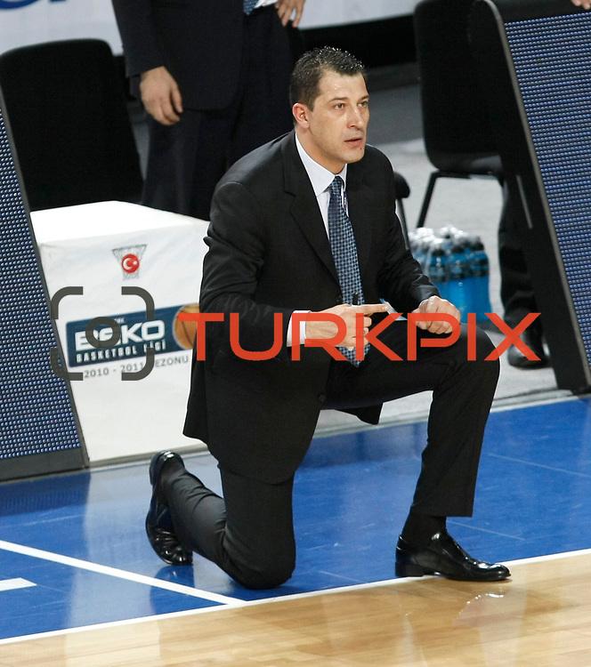 Efes Pilsen's coach Ufuk SARICA during their Turkish Basketball league match Efes Pilsen between Banvit at the Sinan Erdem Arena in Istanbul Turkey on Saturday 02 April 2011. Photo by TURKPIX