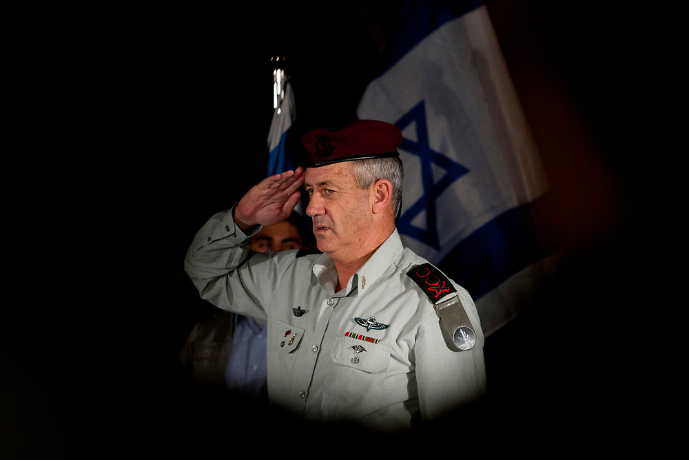 IDF Chief of Staff, Lieutenant-General Benny Gantz, salutes as he attends a ceremony honoring reserve units of the IDF, at the President's Residence in Jerusalem on July 4, 2011.