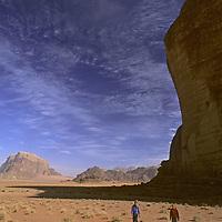 Hikers walk below Jebel [Mount] Khaz Ali in the Wadi Rum, Jordan. (MR)
