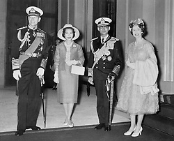 King Bhumibol Adulyadej and Queen Sirikit of Thailand with Queen Elizabeth II and the Duke of Edinburgh at Buckingham Palace after their processional drive from Victoria Station at the start of the Thai royal couple's State visit.