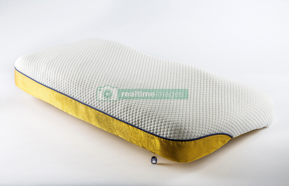 """April 27, 2017 - inconnu - A hand-made pillow promising the most comfortable night's sleep is the stuff of dreams - thanks to a $59,995 USD / €55.000 Euros price tag.The Tailormade Pillow Gold edition, said to be the world's most expensive, has a 24 carat gold cover. The company was first in the world to develop make real gold fabric.Besides the luxury that gold provides, it's also known to be one of the best electromagnetic radiation blocker which helps create a healthier sleeping environment. There is also a gold zipper set with a 22.5 carat sapphire stone.It's the ultimate version of the standard Tailormade Pillow which costs a slightly more affordable $4,995 USD / €4.580 EurosApart from the hand-made gold fabric and precious stone on the most expensive version, all pillows, created by Dutch physical therapist Thijs van der Hilst, are made the same way.Each is made to order using a 3D scanner capture the dimensions and shape of the customer's head and shoulders With this image, a simulation is made to ensure every sleeping position will be correctly integrated in the pillow. A complex and patented algorithm is made to determine the exact shape and size of every individual pillow.Thijs said:"""" Every pillow is uniquely designed to give our clients the best support in every way. """"Whether you're a side, back or stomach sleeper, all positions are supported in your personal Tailormade Pillow. Even the left and right side of the pillow may vary.""""The next stage is a state-of-the-art robotic 3D-milling machine to cut and shape the pillow filling which is made of premium Dutch memory foam to the customer's fitting.The standard gets a cooling tencel cover and a mulberry silk of Egyptian cotton pillowcase, depending on customer order.All are hand made to be a custom fit as no two pillows will be the same.The final touch of luxury sees the customer's name embroidered on the pillow.The Gold Edition is mad t"""