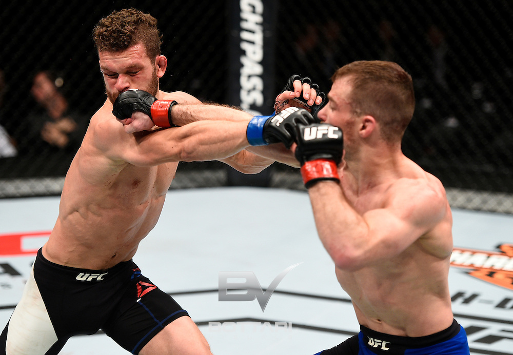 TORONTO, CANADA - DECEMBER 10:  (R-L) Zach Makovsky punches Dustin Ortiz in their flyweight bout during the UFC 206 event inside the Air Canada Centre on December 10, 2016 in Toronto, Ontario, Canada. (Photo by Jeff Bottari/Zuffa LLC/Zuffa LLC via Getty Images)