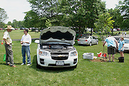 Hamptonburgh, NY - A Chervolet Equinox fuel cell electric vehicle, at left, is on display at the Orange County Earth and Water Festival sponsored by Orange County, Orange Environment and the Orange County Water Authority on June 7, 2008. The pair on the right are planting a tree.