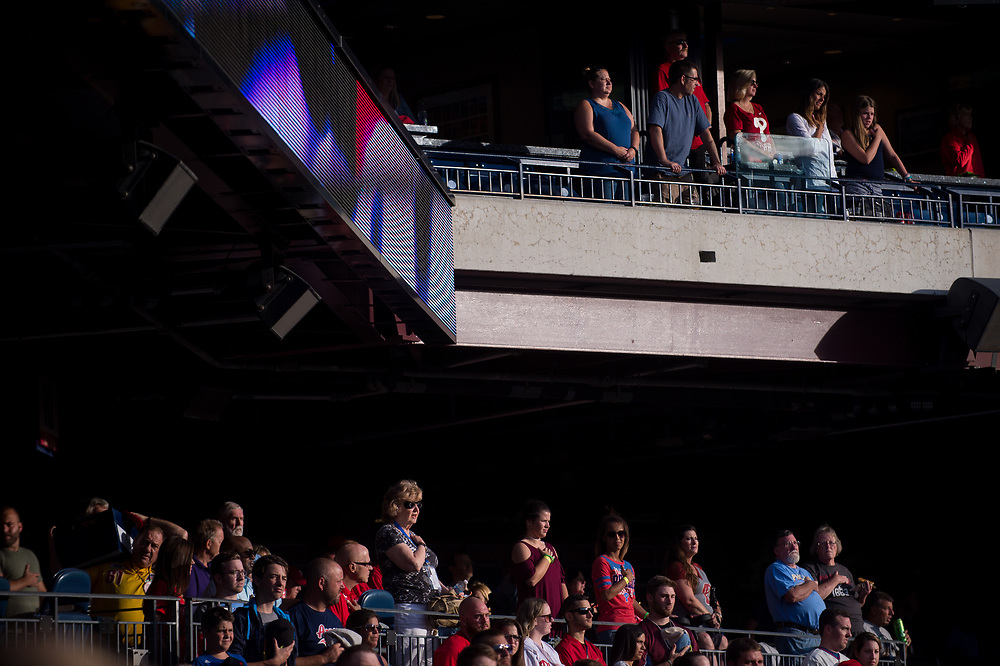 Fans stand for the National Anthem before the Phillies face the braves.