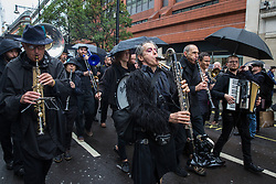 London, UK. 12 October, 2019. Musicians join thousands of climate activists from Extinction Rebellion taking part in the XR funeral march from Marble Arch to Russell Square on the sixth day of International Rebellion protests to demand a government declaration of a climate and ecological emergency, a commitment to halting biodiversity loss and net zero carbon emissions by 2025 and for the government to create and be led by the decisions of a Citizens' Assembly on climate and ecological justice. Credit: Mark Kerrison/Alamy Live News