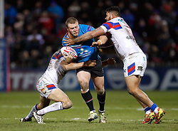 Salford Red Devils' Josh Jones is tackled by Wakefield Trinity's Reece Lyne (left) and David Fifita during the Betfred Super League match at Belle Vue Stadium, Salford.