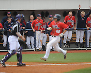 The Rebel dugout cheers as Ole Miss' Holt Perdzock (42) scores in the 7th inning vs. Lipscomb's Taylor Stewart at Oxford-University Stadium in Oxford, Miss. on Sunday, March 10, 2013. Ole Miss won 9-8. The Rebels improve to 16-1.