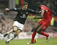 Fotball<br /> England 2004/22005<br /> Foto: SBI/Digitalsport<br /> NORWAY ONLY<br /> <br /> Liverpool v Manchester United<br /> FA Barclays Premiership<br /> 15/01/2005<br /> <br /> Liverpool's Djimi Traore and United's Cristiano Ronaldo