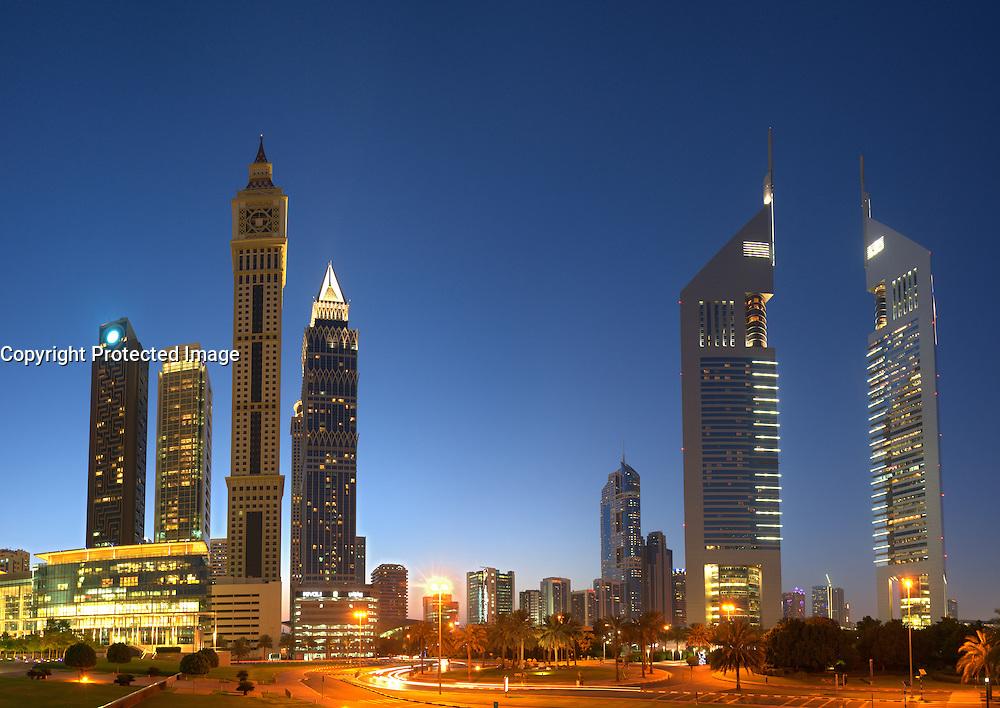 Night skyline view of financial district in Dubai United Arab Emirates
