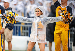 Sep 8, 2018; Morgantown, WV, USA; A West Virginia Mountaineers cheerleader performs during the second quarter against the Youngstown State Penguins at Mountaineer Field at Milan Puskar Stadium. Mandatory Credit: Ben Queen-USA TODAY Sports