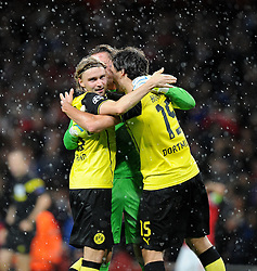 Borrusia Dortmund's Marcel Schmelzer celebrate there win over arsenal with goal keeper Borrusia Dortmund's Roman Weidenfeller - Photo mandatory by-line: Alex James/JMP - Tel: Mobile: 07966 386802 22/10/2013 - SPORT - FOOTBALL - Emirates Stadium - London - Arsenal v Borussia Dortmund - CHAMPIONS LEAGUE - GROUP F