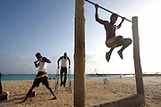 In Santa Maria beach, the touristic center of Sal island, youngs work out their bodies to impress tourists.