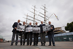 © Licensed to London News Pictures. 18/09/2013. London, UK. Fred Honisett, 88 (L), Don Staddon, 88 (2L), Derek Ings, 88 (3L), Sid Hunt, 89 (3R), Leslie Taylor, 89 (2R) and Stanley Mayes, 88 (R), all World War Two veterans of the Merchant Navy, hold new Royal Mail stamps showing scenes from World War Two Atlantic and Arctic convoys during their launch at the Cutty Sark in Greenwich, London, today (18/09/2013). The stamps, issued along with others depicting famous merchant ships including the Cutty Sark, are available from the 19th of September 2013. Photo credit: Matt Cetti-Roberts/LNP