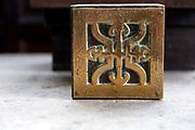 Christian religious symbols brass object on altar, Thelnetham, Suffolk, England, UK