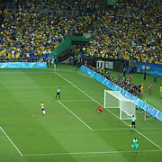 Football - Olympics: Day 15  Rafinha #8 of Brazil scores from the penalty spot during the penalty shoot out beating Timo Horn #1 of Germany during the Brazil Vs Germany Men's Football Gold Medal Match at Maracana on August 20, 2016 in Rio de Janeiro, Brazil. (Photo by Tim Clayton/Corbis via Getty Images)