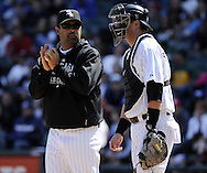 CHICAGO - JUNE 12:  Manager Ozzie Guillen #13 of the Chicago White Sox makes a pitching change against the Oakland Athletics on June 12, 2011 at U.S. Cellular Field in Chicago, Illinois.  The White Sox defeated the Athletics 5-4.  (Photo by Ron Vesely)   Subject:  Ozzie Guillen