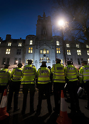 © Licensed to London News Pictures. 05/12/2016. London, UK. A line of police guard the Supreme Court in Westminster, London at the end of the first day of a Supreme Court hearing to appeal against a November 3 High Court ruling that Article 50 cannot be triggered without a vote in Parliament. Photo credit: Peter Macdiarmid/LNP