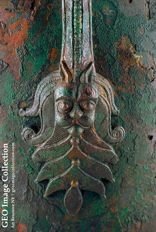 A detail view of the handle of a flagon.